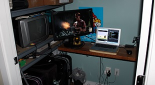 Matthew Langille's home office set-up at Sprixelsoft. Pay attention to the NES hooked up to a small CRT television as well as the super mario poster on his wall