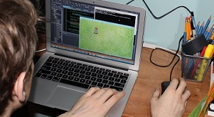 indie developer Matthew Langille working at his hope office in Vancouver on getting a game engine up and running for Sprixelsoft's game Super Hematoma. We used a sprite from Crono Trigger as a test to get things moving on the screen